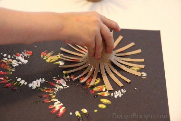 Fireworks-painting-using-DIY-toilet-paper-roll-stampers